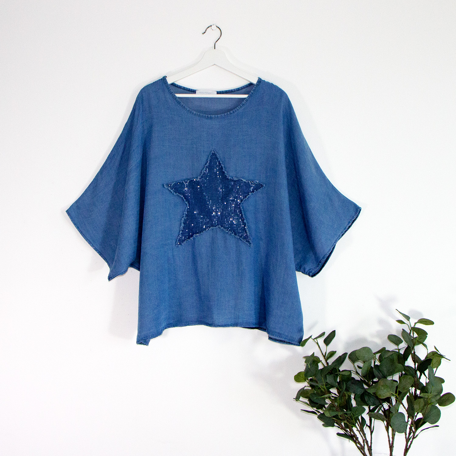 Jeans style tencel top with sequin star motif and frayed edge