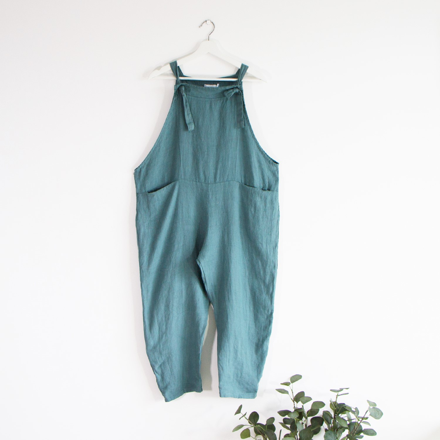 Linen dungarees with tie detail and pockets